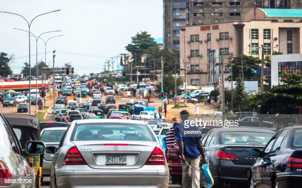african city traffic - abuja, nigeria - abuja stock photos and pictures