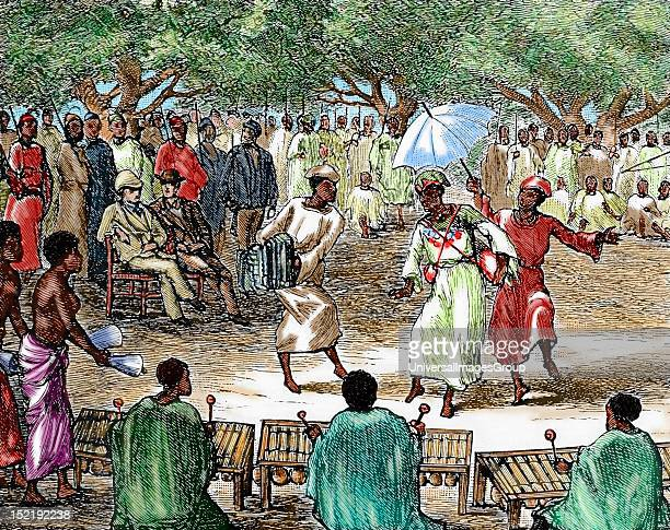 African colonialism Explorers attending a party in his honor in Niger Nineteenthcentury colored engraving