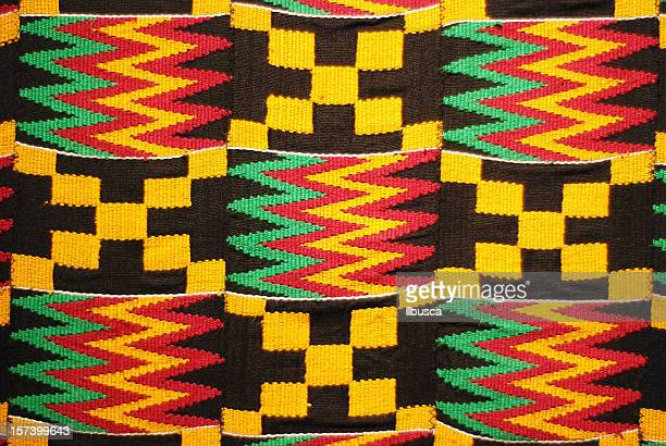 african colored pattern fabric background - ghana stock pictures, royalty-free photos & images