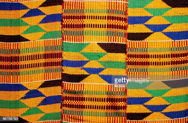 african colored pattern fabric background - afrika stockfoto's en -beelden
