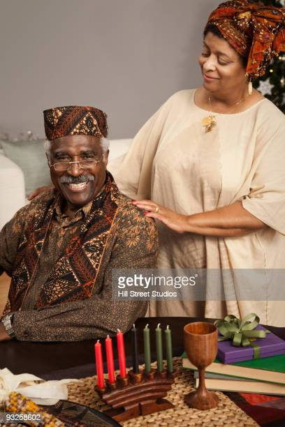 african couple celebrating kwanzaa - gardena california stock pictures, royalty-free photos & images