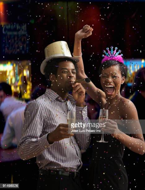 African couple celebrating New Year's Eve in nightclub