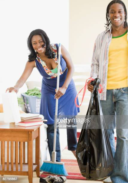 African couple cleaning house