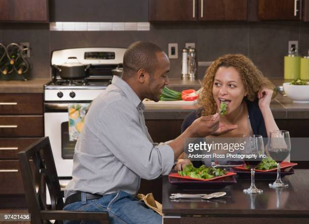 African couple eating healthy meal