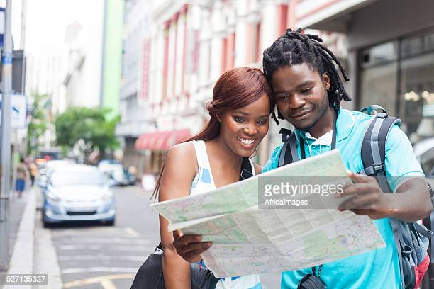 African couple looking for their next destination.
