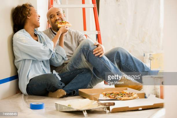 African couple taking lunch break from painting