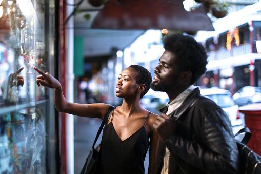 African couple window shopping. - gettyimageskorea