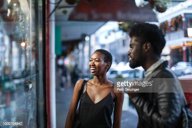 African couple window shopping.