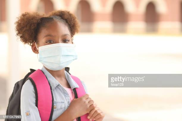 african descent, girl on school campus. mask for covid-19. - school child stock pictures, royalty-free photos & images