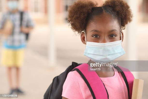 african descent, girl on school campus. mask for covid-19. - school building stock pictures, royalty-free photos & images