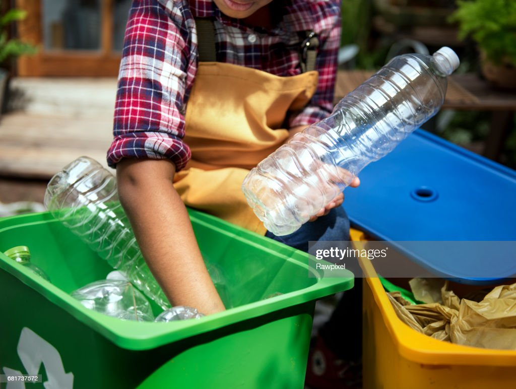 African Descent Kid Separating Recyclable Trash : Stock Photo