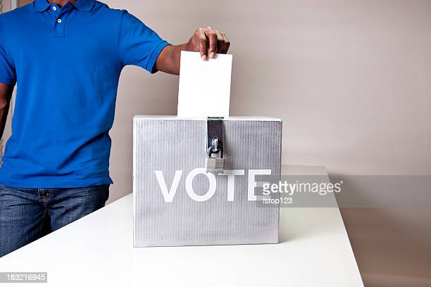 African descent man casting his vote. Ballot box.