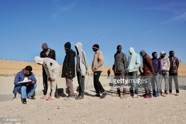 CENTER BENGHAZI LIBYA FEBRUARY 2 2019 African detainees wait in line in the compound before the daily morning roll call at Qanfoodah Detention Center...