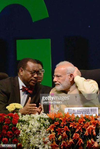African Development Bank President Akinwumi Adesina speaks with Indian Prime Minister Narendra Modi at the start of the African Development Bank...