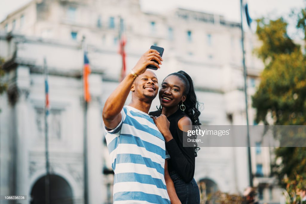 African Diverse Couple Traveling Across Europe Noncaucasian Travelers In London High Res Stock Photo Getty Images