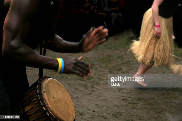 African Drummer and woman dancing during carnival