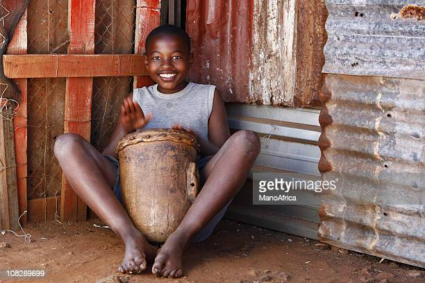 african drummer boy - metal music stock photos and pictures