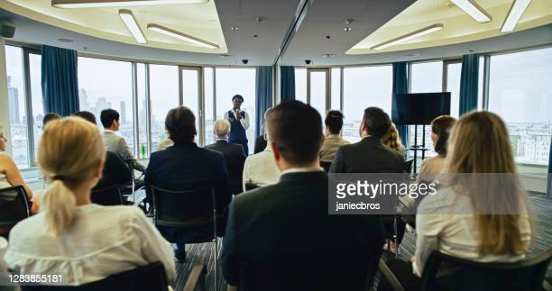 african ethnicity businessman delivering a speech during a conference - candidate stock pictures, royalty-free photos & images