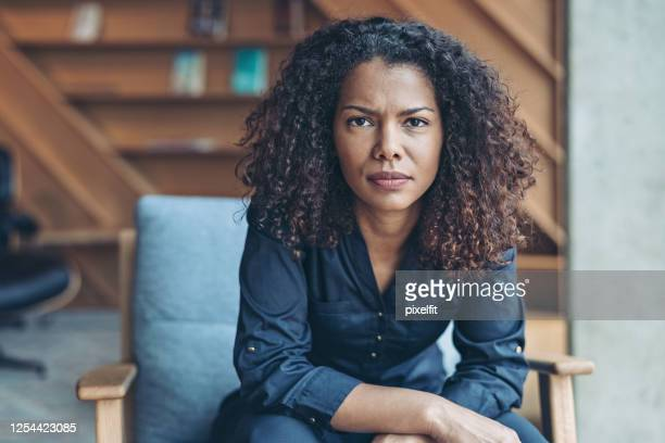 african ethnicity businesswoman with a serious expression - sayings stock pictures, royalty-free photos & images
