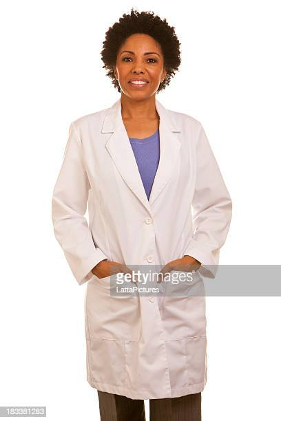 African ethnicity female wearing lapcoat with hands in pockets