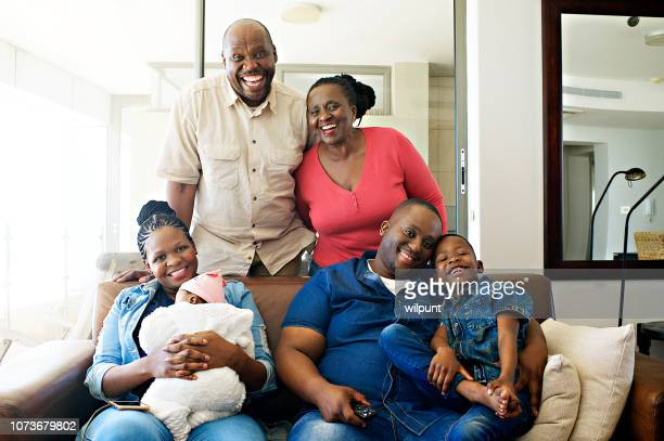 african ethnicity multi-generational family formal portrait smiling - south african culture stock photos and pictures
