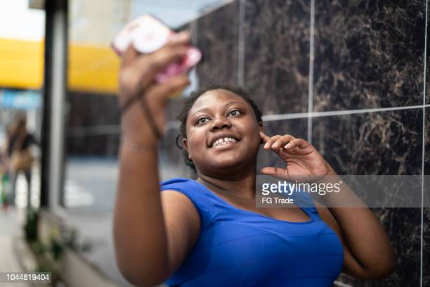 african ethnicity woman taking a selfie - ugly black women stock photos and pictures