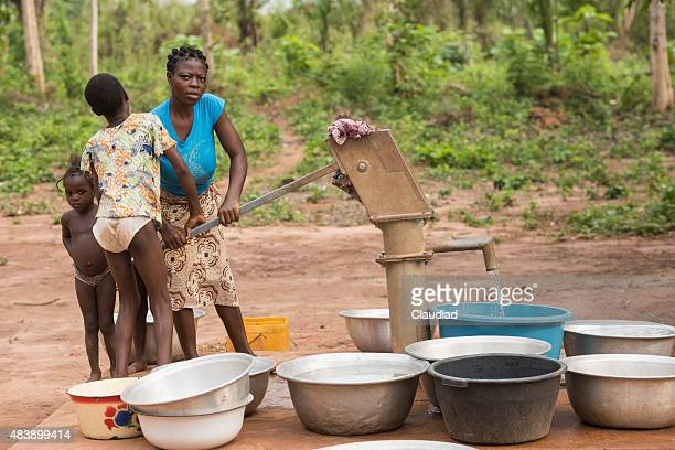 African family at a well