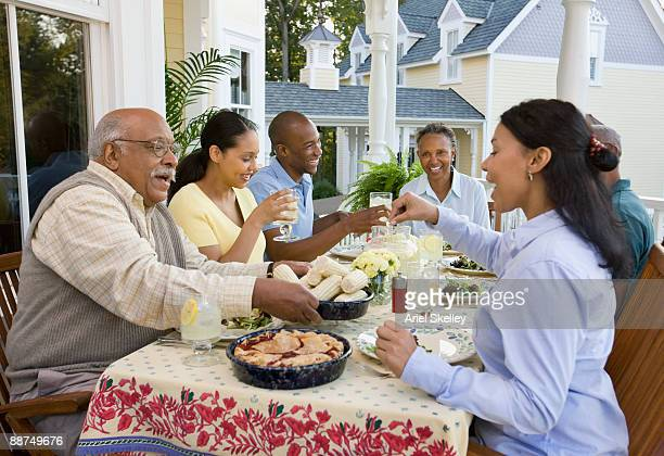 African family eating dinner outdoors