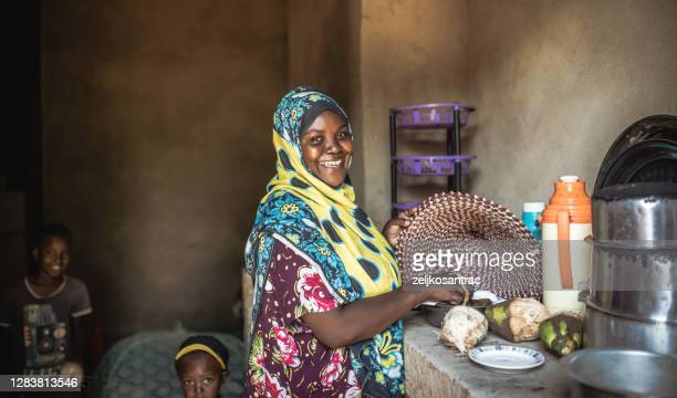 african  family eating healthy food together - east africa stock pictures, royalty-free photos & images