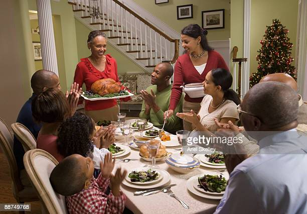 african family eating holiday dinner - black family dinner stock photos and pictures