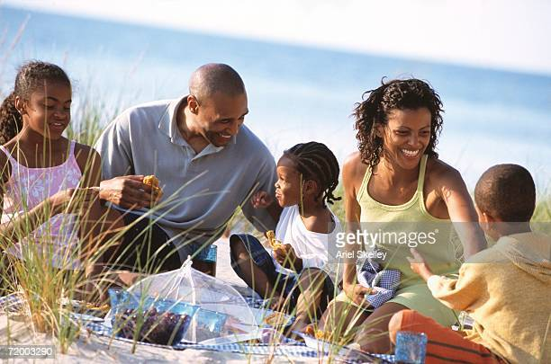 African family having picnic on beach