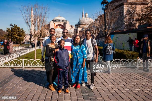 african family in front of hagia sophia in istanbul, turkey - ottoman empire photos stock pictures, royalty-free photos & images