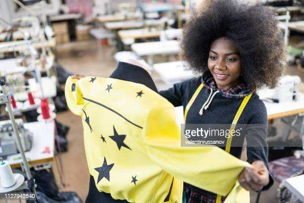 african fashion designer creating new products in factory - fashion collection stock pictures, royalty-free photos & images