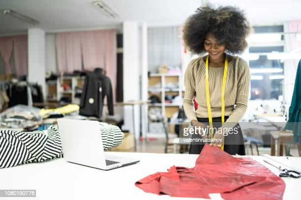 african fashion designer creating new products in studio - fashion designer stock photos and pictures