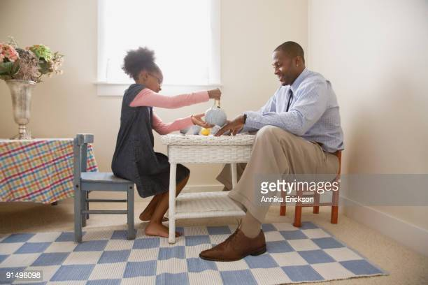african father and daughter playing tea - tea party stock pictures, royalty-free photos & images