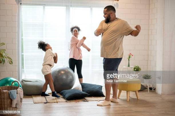 african father and his two daughter morning exercise at home. - genderblend stock pictures, royalty-free photos & images