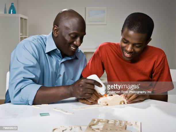 African father and son building model car
