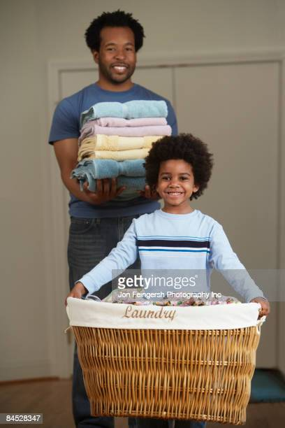 African father and son doing laundry