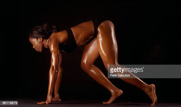 African female athlete in running position