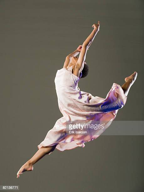 african female ballet dancer jumping - modern dancing stock pictures, royalty-free photos & images