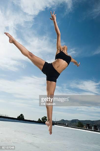 African female ballet dancer jumping