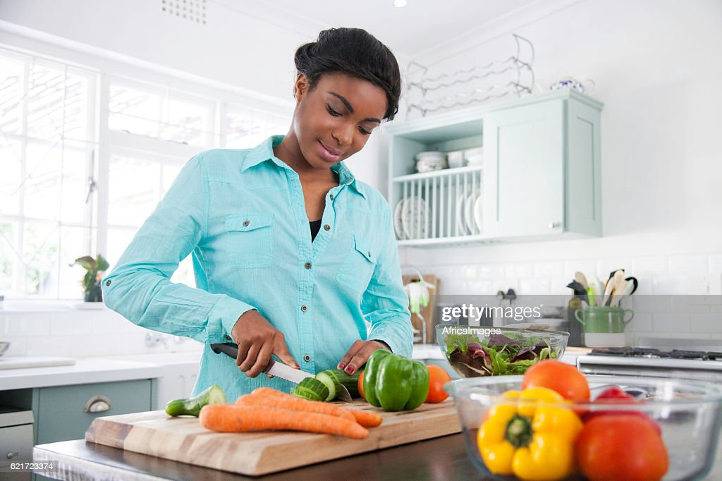 African female cooking up a storm. : Stock Photo