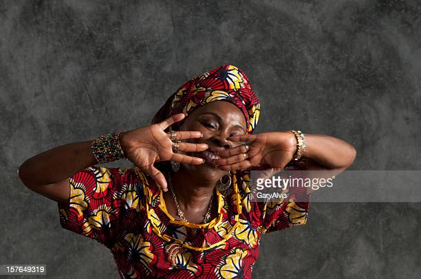 African female dancer/hands in front of face,eyes shut/close up