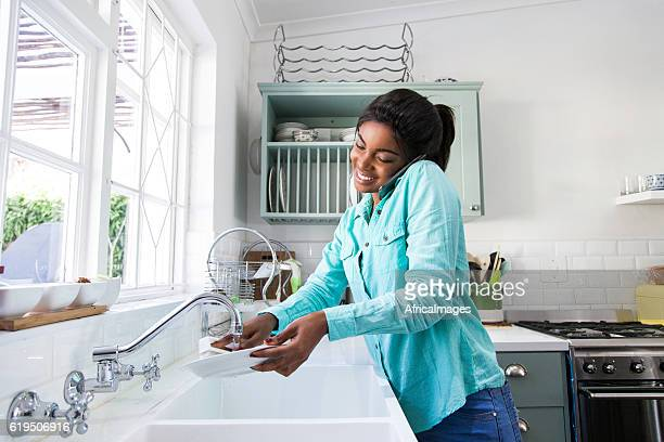 African female doing the dishes.