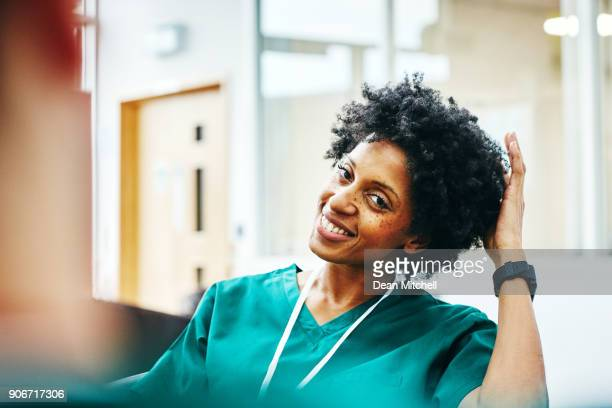 african female medic relaxing during work break - female doctor stock photos and pictures