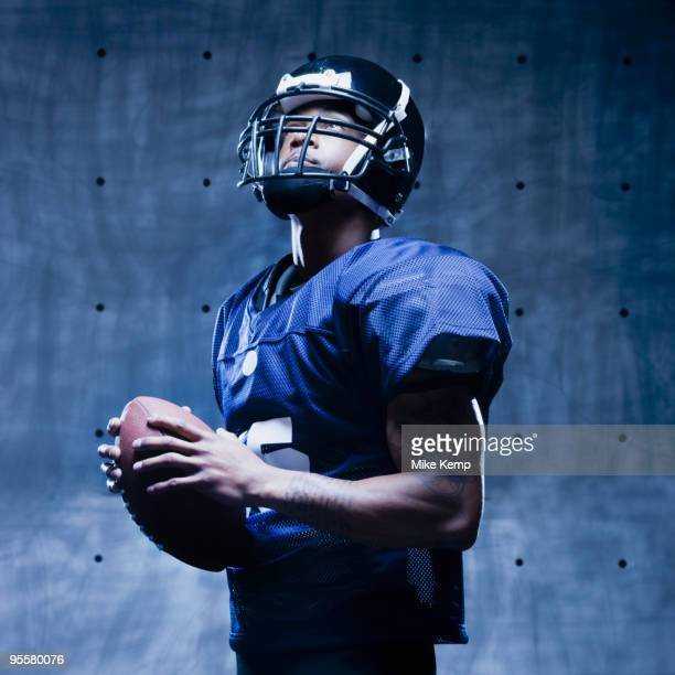 african football player holding football - safety american football player stock pictures, royalty-free photos & images