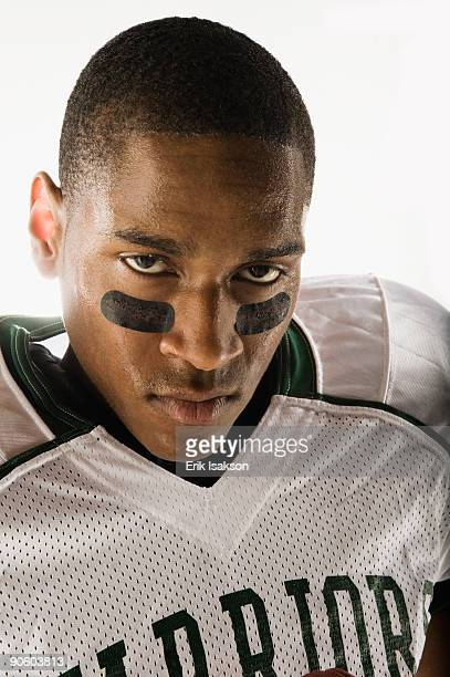 african football player with face paint under eyes - eye black stock photos and pictures