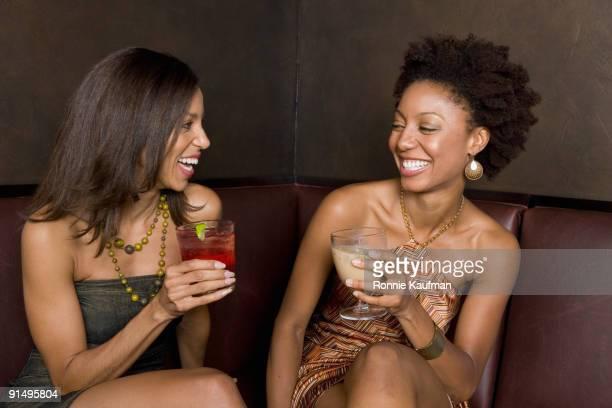 african friends hanging out in nightclub - alleen mid volwassen vrouwen stockfoto's en -beelden