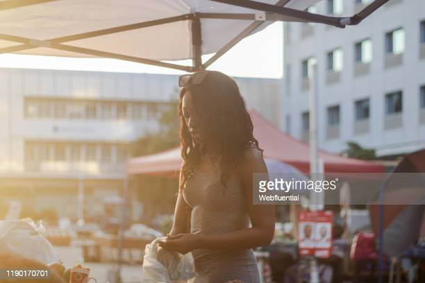 african girl at a market - webfluential stock pictures, royalty-free photos & images