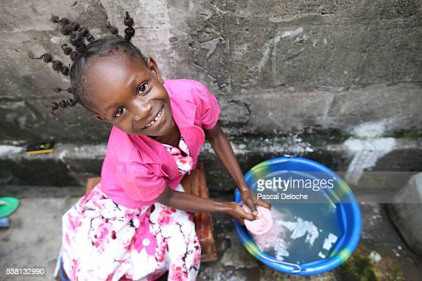 African girl doing laundry